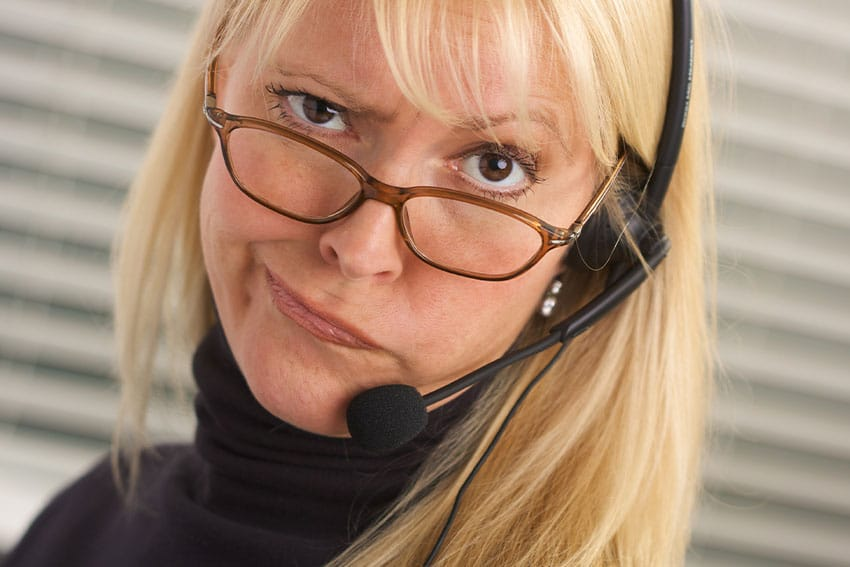 irrated woman with headset on the phone