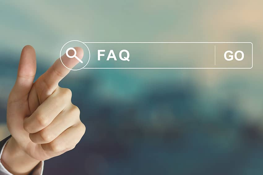 male hand pointing to futuristic faq on computer screen